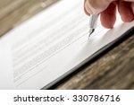man signing business document ... | Shutterstock . vector #330786716
