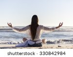 woman doing yoga on the beach  | Shutterstock . vector #330842984