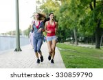 two women jogging in park and... | Shutterstock . vector #330859790