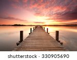 long pier leading out onto the... | Shutterstock . vector #330905690