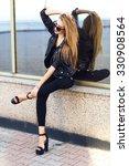 stylish lady in black  posing... | Shutterstock . vector #330908564