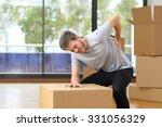 man suffering back ache moving... | Shutterstock . vector #331056329