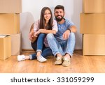 young happy couple sitting on... | Shutterstock . vector #331059299