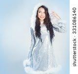 beauty brunette girl in santa... | Shutterstock . vector #331086140