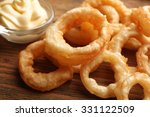 chips rings with red sauce on... | Shutterstock . vector #331122509