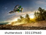 dirt bike rider is flying high... | Shutterstock . vector #331139660