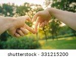 closeup of hands showing heart... | Shutterstock . vector #331215200