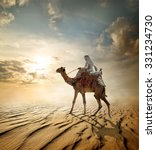 Bedouin Rides On Camel Through...
