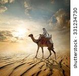 Bedouin Rides On Camel Through...