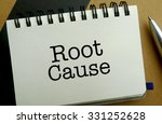 Root cause memo written on a notebook with pen - stock photo