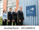 businesspeople standing in a...