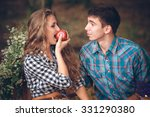 Happy Couple With An Apple...