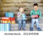 children enjoy gifts. two cute... | Shutterstock . vector #331345508