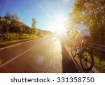 Cyclist On Road Bike In Sunset...