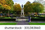 Small photo of TROWBRIDGE - OCT 25: People walk through a public park on Oct 25, 2015 in Trowbridge, UK. The UK experiencing an 'Indian Summer' with above average temperatures and stunning fall colours.