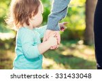 toddler girl holding hands with ... | Shutterstock . vector #331433048
