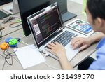 asian developer using laptop... | Shutterstock . vector #331439570