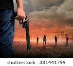 Man Hand Holding Gun With...