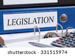 Small photo of Legislation - blue binder with text