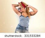 pin up woman in studio | Shutterstock . vector #331533284