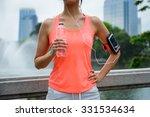 sweaty woman drinking water... | Shutterstock . vector #331534634