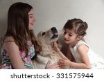 sisters playing with your dog   Shutterstock . vector #331575944