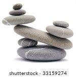 balancing pebbles isolated on white - stock photo