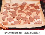 christmas cookies on baking tray | Shutterstock . vector #331608014