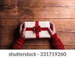 man holding christmas present... | Shutterstock . vector #331719260