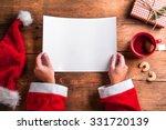 Santa Claus Holding An Empty...