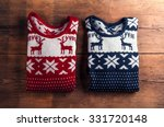Two Winter Sweaters Laid On A...