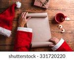 santa claus holding an empty... | Shutterstock . vector #331720220