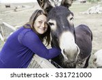 woman playing naturally donkey... | Shutterstock . vector #331721000