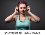 sporty woman with headphones | Shutterstock . vector #331740326