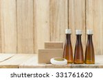 Small photo of Tubes of bathroom amenity contains on wooden background