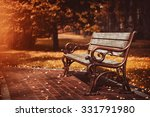 Old Wooden Bench In City Park....