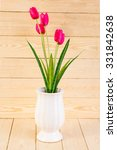 red tulips in pot on wood... | Shutterstock . vector #331842638