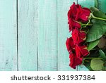 Stock photo bouquet of red roses on a light wooden background top view 331937384
