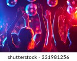 Stock photo crowd of people with raised arms dancing in night club 331981256