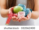 green apple and measure tape in ... | Shutterstock . vector #332062400