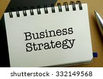 Business strategy memo written on a notebook with pen - stock photo