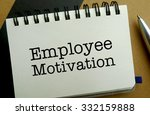 Employee motivation memo written on a notebook with pen - stock photo