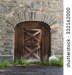 Old Wooden Door In A Stone Bar...