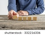 front view of a man placing... | Shutterstock . vector #332216336