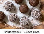 Coconut Rum Balls Being Covered ...