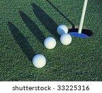 Four Golf Balls Heading Toward...