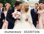 handsome brunette groom kissing ...   Shutterstock . vector #332307146