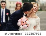 handsome brunette groom kissing ... | Shutterstock . vector #332307938