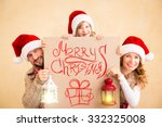 Happy Family Holding Christmas...