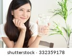 woman drinking a glass of water | Shutterstock . vector #332359178